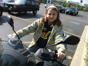 Kira models the comfortable riding position an Big Smile that the Piaggio delivers